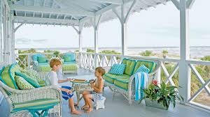 Children Play In The Protected Shade Of A Covered Beach Porch