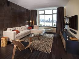 Small Apartment Living Room In Rustic Style With Fur Rug And Glass Coffe Table