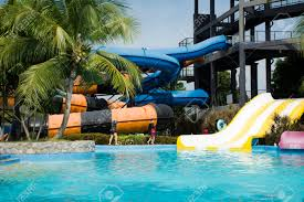 Travelers People Playing Big Slide Water And Swimming In Pool