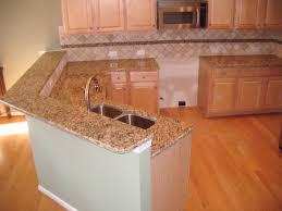 santa cecelia granite looks with light cabs kitchen