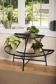 Semi Circle Patio Furniture by Semi Circular Metal Plant Stand Black Tubular Steel