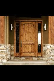 Add A Beautiful Designers Touch To Your Home With This Krosswood Doors Rustic Knotty Alder Top Rail Arch Solid Unfinished Wood Front Door Slab