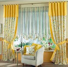 yellow blossom fabric curtains on the hook connected by yellow