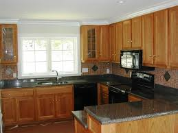 light wood kitchen cabinets with black countertops imanisr