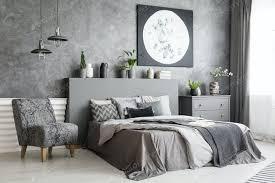sessel neben bett in grau schlafzimmer interieur mit mond plakat o foto bialasiewicz auf envato elements