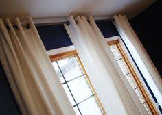 white ikea merete curtains and bamboo shades add a light airy