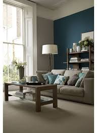 beige living room with teal accent wall lovely living rooms