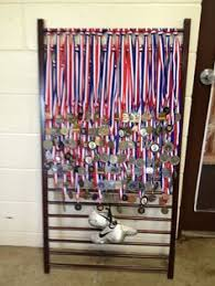 My Nieces Track Medals Displayed On A Repurposed Crib Side