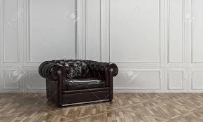 große schwarze ledersessel mit taste zurück in einem klassischen wohnzimmer interieur mit weißen holzvertäfelung an den wänden und gemusterten