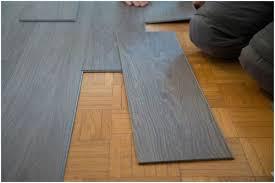 Prefinished Hardwood Flooring Pros And Cons by Hardwood Flooring Labor Cost Charming Light Vinyl Vs Laminate