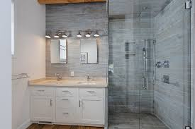 wood tile bathroom use white subway tile mixed with marble accent