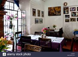 Beautiful Light Filled Rustic Interior Of Oaxacan Home Style Restaurant With Family Photos On Wall In Oaxaca City Mexico