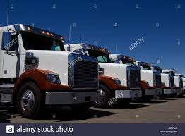 Rows Of Brand New Semi-Trucks Parked At A Dealership In The United ... Semi Trailer Truck Logos Logo Template Logistic Trick Isolated Vector March 2017 Rc4wd Gelande Ii Kit 110 Chassis Food Download Free Art Stock Graphics Images Vintage Hand Lettered Decals Artcraft Sign Co Logo Design Mplate Traffic Or Royalty Illustrator Tutorial Design Youtube Commercial Truck Stock Vector Illustration Of Cartoon 21858635 Mack Trucks Pinterest Trucks And Dale Jr 116scale Hauler With Photos And Diet Mountain