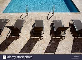 Chaise Lounge Chairs, Hotel Pool, Puerto Rico Stock Photo ... Pool Interior Chaise Longue Armchair Chair Trees Colorful Stackable Patio Fniture Lounge Chair Alinum Carlsbad Gray Wicker Chaise Products In 2019 Couch Vintage Rhanciepointcom French Upholstered Homall Outdoor Adjustable Poolside Set Portable And Folding Pe Rattan 1 Chairs By The Stock Image Of Remarkable Cushions Amusing Cozy For Exciting Commercial Recliner Automatic Back With 100 Olefin Cushion Beige Coral Coast Emersin Sling Outdooraise Loungeair Amazoncom Wo Westin Outdoor Hermosa