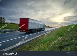 Truck Driving On Highway Toward Horizon Stock Photo (Edit Now ...