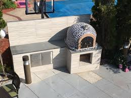 wood burning pizza oven with cast iron door tile mosaic