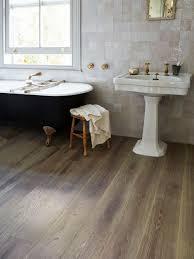 Antique Grey Oak Flooring In A Bedroom And En Suite