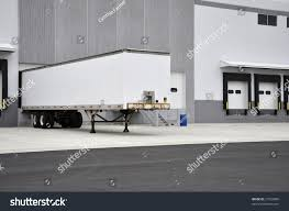 One Truck By Warehouse Loading Dock Stock Photo 21032890 ... Home Nova Technology Loading Dock Equipment Installation Lifetime Warranty Tommy Gate Railgate Series Dockfriendly Mson Tnt Design The Determine Door Sizes Blue Truck At Image Scenario Cpe Rources Dock With Truck Bays In Back Of Store Stock Photo Ultimate Semi Back Up Into Safely Reverse Drive On Emsworth Ptoons And Floating Platforms Inflatable Shelter Stertil Products Freight Semi Trucks Cacola Logo Loading Or Unloading At