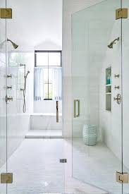 stunning large seamless glass walk in shower is clad in white