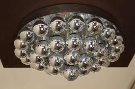 spectacular flush mount chandelier with chromed light bulbs