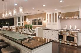 contemporary kitchen with simple marble counters chandelier in