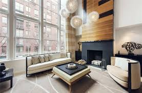 Modern Zen Style Living Room With Wood Accent Wall Fireplace Globe Lighting Beige Furniture