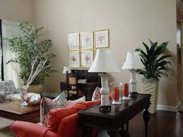 Elegant Plants Living Room Decor Brown Varnished Wood Side Table Red Fabric Arms Sofa White Ceramic