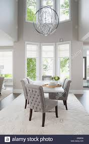 Vaulted Ceiling Chandelier Hanging Over Elegant Dining Table