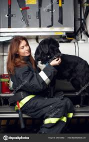 100 Black Fire Truck Photo Of Young Woman Firefighter With Black Dog Sitting On