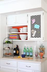 Quirky And Beautiful White Open Shelves Design Inspiration With Orange Colored Inner Black