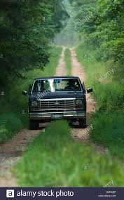 Old Pickup Truck Driving Down A Dirt Road In The Forest, Columbus ... Old Pickup Truck Driving Down A Dirt Road In The Forest Columbus Inspirational Nissan Trucks Bc 7th And Pattison Freightliner Flatbed In Georgia For Sale Used On Car Dealerships And Phenix Cityopelika Cars At Sports Imports Ga Autocom Memphis Buyllsearch Volkswagen Passat Cargurus