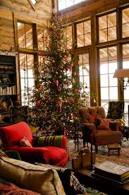 Decoration Stunning Cabins At Christmas Mountain With Medium Height Pine Trees Aside Flower Pattern Couches And