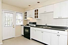 Kitchen Layout With Awesome Minimalist Remodeling Interior White Plywood Cabinets System Combine Black Glass Tile Countertop And