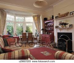 Living Room With Fireplace And Bay Window by Stock Photo Of Dining Table And Chairs In Bay Window Of Living