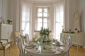 Pottery Barn White Curtains With Oak Club Chairs Dining Room Traditional And Neutral Colors Floral Arrangement