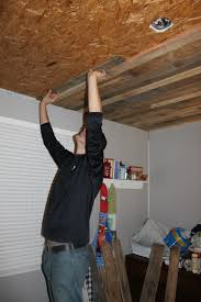 Affordable Basement Ceiling Ideas by Remodelaholic Rustic Pallet Wood Ceiling Tutorial