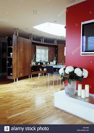 100 Gw Loft Apartments Vase Of White Flowers On Low Unit In Dining Area In Large Openplan