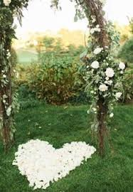 Floral Wedding Arch With Rose Petal Heart Underneath By Terris Flower Shop In Naugatuck
