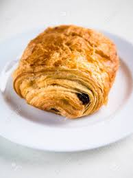 Vertical View Of A Single French Chocolate Croissant On White