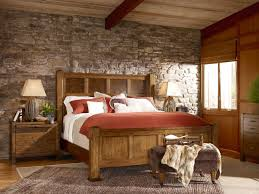 Natural Stone Wall In Rustic Bedroom Ideas With Wide Bed And Simple Maple Nightstands