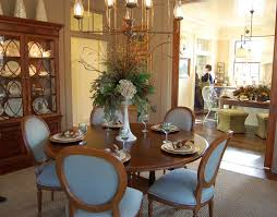 Incredible Rounded Brown Wooden Dining Table And Blue Fabric Five Chairs Set As Well Flowers Room Centerpieces Added
