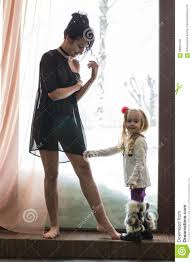 mom in black dress and little stock photo image 88897442