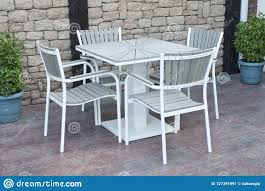 Metal And Gray Wood Outdoor Patio Furniture For Dining Stock ...