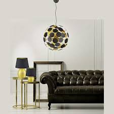 verspielte pendelleuchte für tolle lichteffekte in schwarz und gold haus
