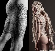 Runestone Tattoo With Complimentary Nordic Designs And Naturalistic Back Piece The Essential Black Gray
