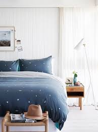 Mid Sized Contemporary Painted Wood Floor And White Bedroom Idea In Melbourne With