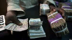 dollar crunch means big business for currency hawkers