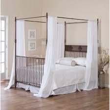 decorating elegant black iron bratt decor crib with white bed and