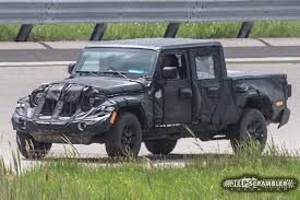 2019 Jeep Pickup (JT) Strips Some Camouflage, Reveals Lights And ... 2019 Jeep Pickup Jt Strips Some Camouflage Reveals Lights And Wrangler Truck Scrambler Toronto Missauga The Upcoming Finally Has A Name Autoguidecom News Caught In Motion On Highway Long Illtrious History Of Trucks Top Speed Protype First Sight 2018 Is Coming In Maxim Hitting Showrooms April 20 Gladiator Vs Pickup Trucks From Chevy Ford Nissan 1978 J20 Off Road Truck Renderings Best Look At New La Auto Show Is Unveiled As New Suv