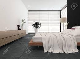 moderne schlafzimmer interieur mit schwarzen und weißen dekor mit einem verstellbaren bett und freistehende stehle mit großen fenstern mit